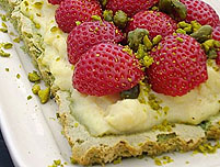 ... pistachio dacquoise cake topped with berries layers of meringue filled